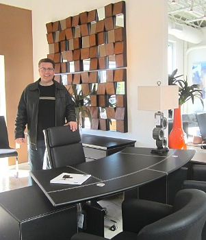 Wonderful Tom Ream Poses With A Contemporary Desk At NIU Urban Living.