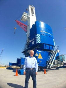 Tim Femster of Foremost Quality Logistics stands in front of a crane at the Port of Brownsville. Femster was one of seven site selectors who spoke at the SiteLink Forum at South Padre Island (Contributed)