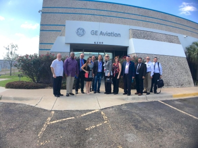 A group of site selectors stand in front of GE Aviation in McAllen. The group was given an all-day tour of the Valley from Brownsville to Anzalduas Park and more.