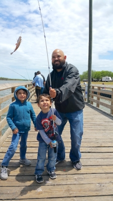 Andy Noriega and his sons, Andy IV and Alex, enjoy a catch along the pier in Arroyo City. Noriega had just purchased some live shrimp for bait at the Bait Stand. (VBR)