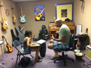 RGVAS instructor Juan C. coaches a young guitar student. (VBR)