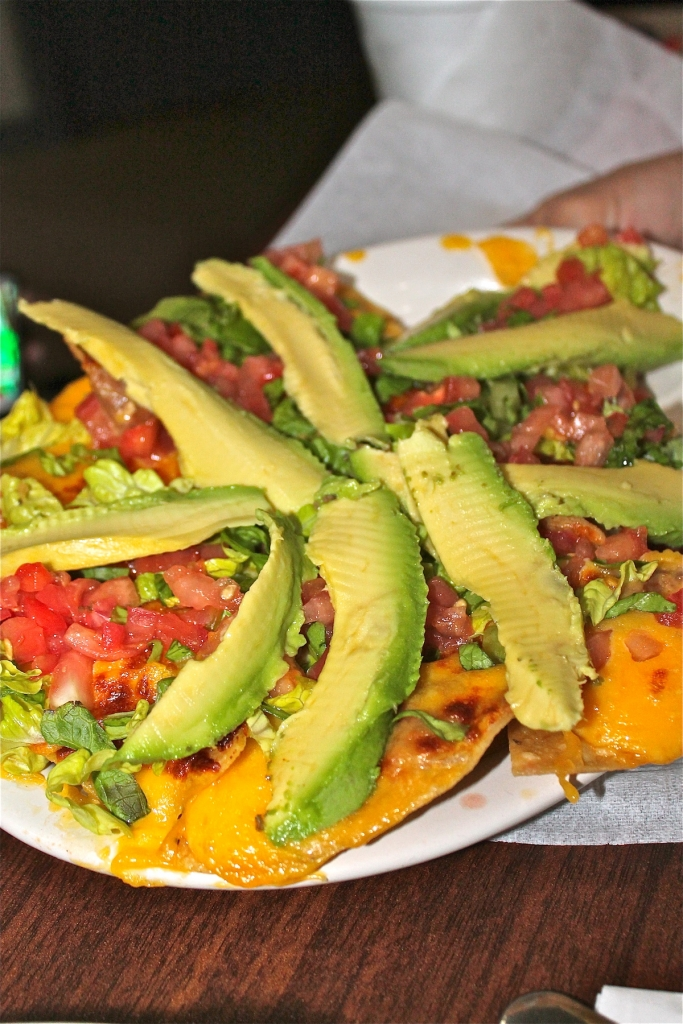 The Vermillion nachos covered with delicious avocado.