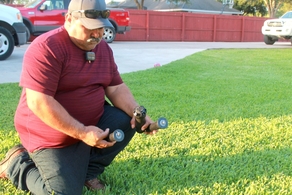 Alfonso Duarte checks on three different sprinkler heads for an upcoming job. (VBR)