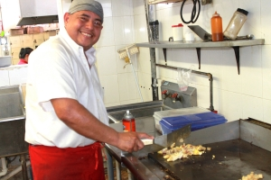 One of Brownsville Coffee Shop No. 2's cooks prepares an afternoon order of ham and egg tacos. The restaurant serves breakfast all day. (VBR)