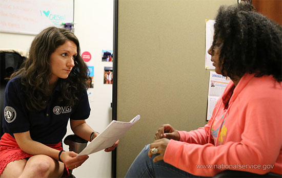 An AmeriCorps VISTA member tutors a student in Washington, D.C. (photo AmeriCorps VISTA)