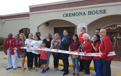 Cremona House owner Miguel Gutierrez celebrates the opening of his stringed instrument store July 13 with the Harlingen Chamber of Commerce,