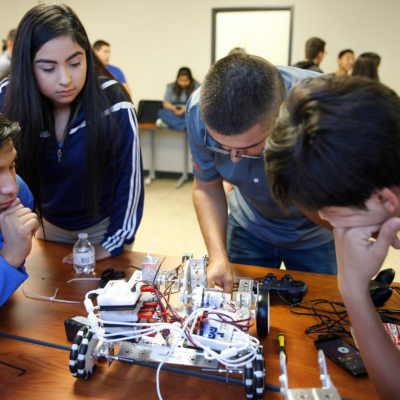 Students perform repairs and modifications on a robot during the UTRGV Texas Manufacturing Assistance Center summer camp in June.