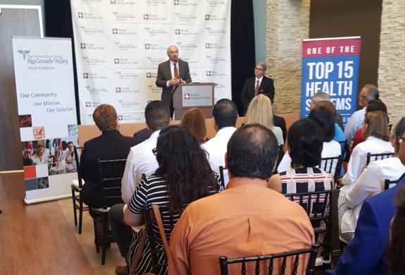 Dr. Guy Bailey, founding president of the University of Texas Rio Grande Valley, speaks at the Knapp/UTRGV Family Practice Residency Clinic ribbon cutting. (photo VBR)