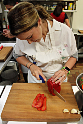A student prepares ingredients for a vegetarian dish. (VBR)