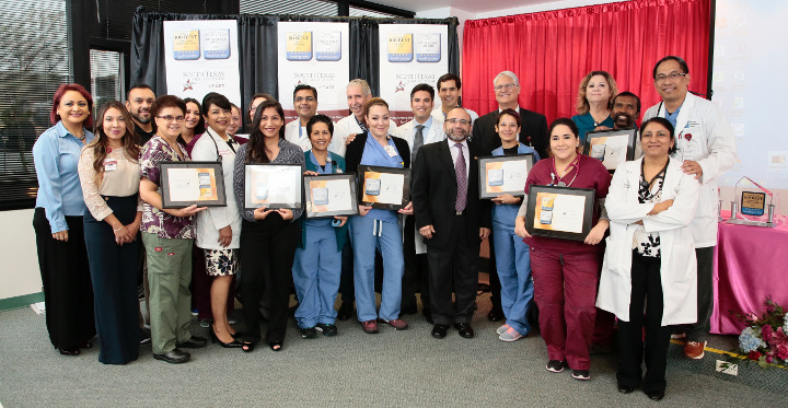 McAllen Heart Hospital staff proudly display the hospitals clinical achievements bestowed by Healthgrades for 2017. (photo by South Texas Health System)