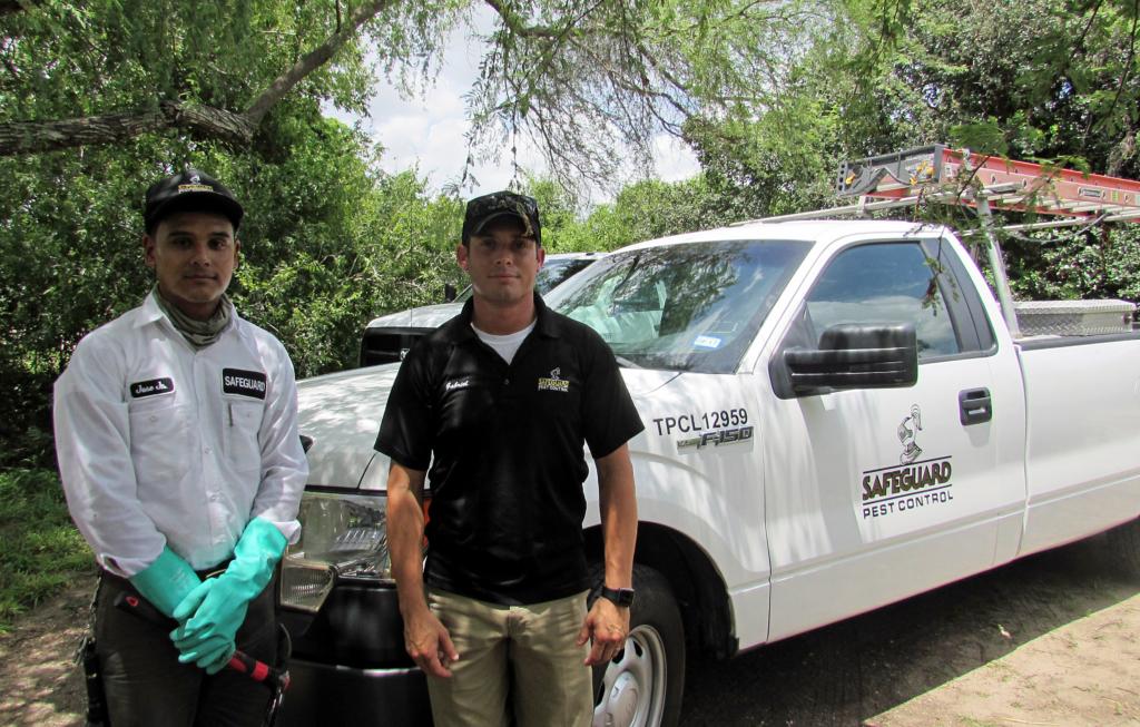 Jose Guerrero and Gabriel Martinez prepare to treat a house for termites. (VBR)