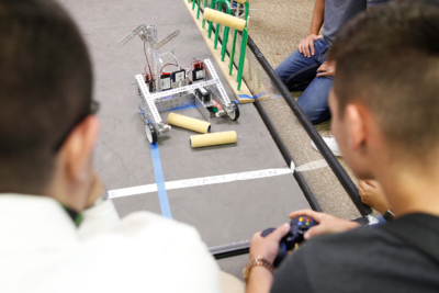 Students guide a robot to collect objects representing crops in the Smart Farm competition during the UTRGV Texas Manufacturing Assistance Center summer camp. (photo Paul Chouy, UTRGV)