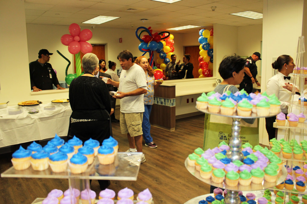 Visitors sample the food at the grand opening of the Pediatric Emergency Room.