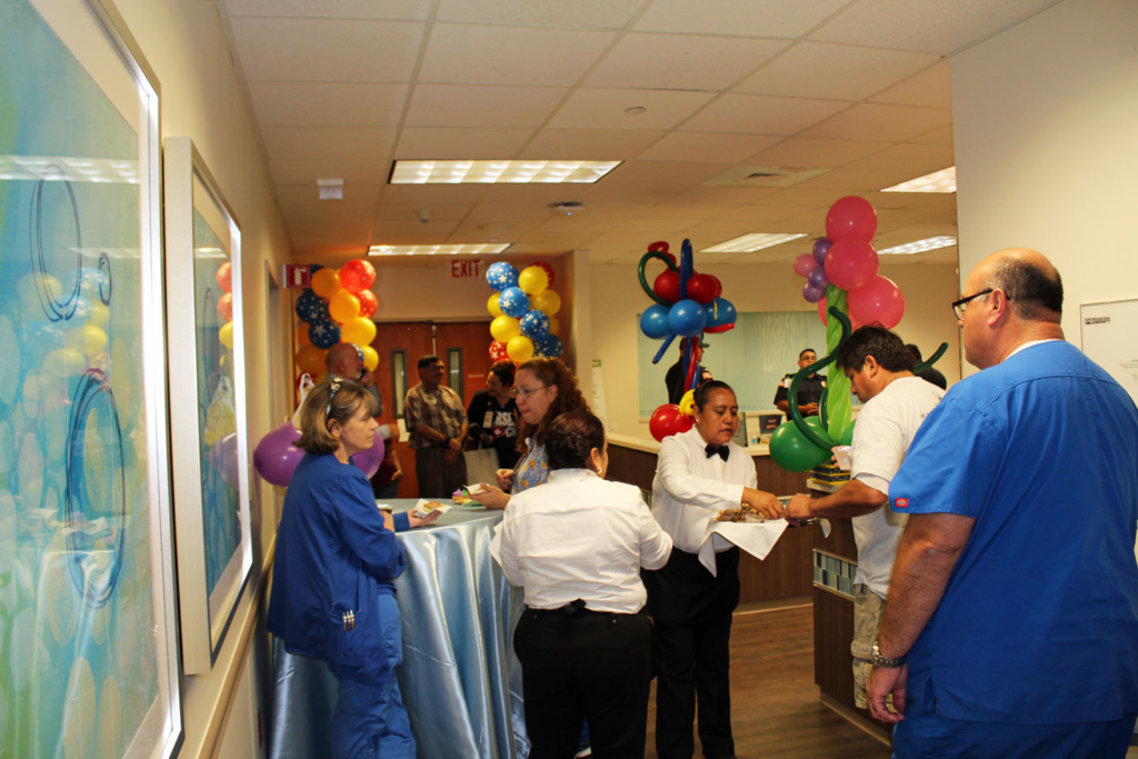 Waiters offered food and drink at the grand opening of the Pediatric Emergency Room.