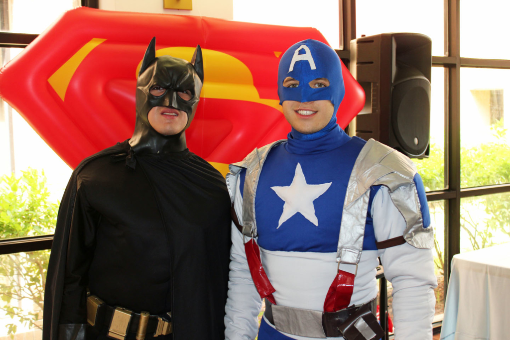 Batman and Captain America were among the superheroes greeting visitors at the grand opening.