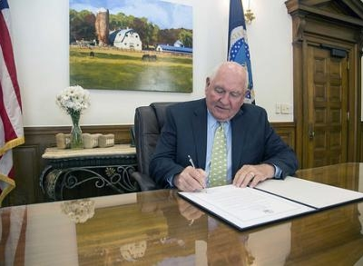 Agriculture Secretary Sonny Perdue signing a proclamation.
