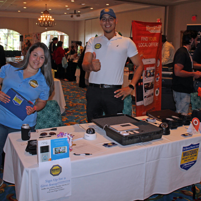 Gisela Muzquiz and Michael Salas represented Muzquiz Security Systems, where they were holding a free raffle for a doorbell video kit with installation.