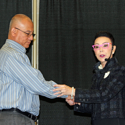 Jan Hargrave demonstrates the body language of a handshake during her presentation.