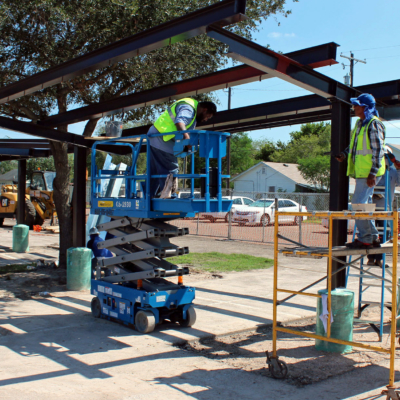 Workers put the finishing touches on a shade structure at the new location for the Harlingen Farmers Market.