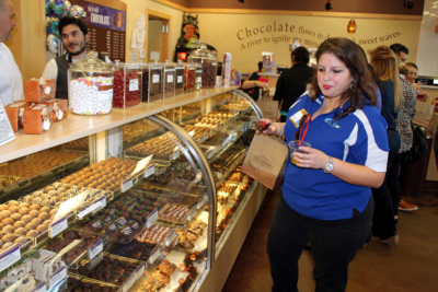 A shopper looks over the sweet treats in display cases. (VBR)