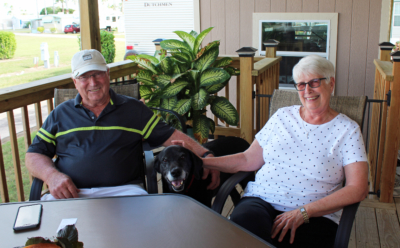 Iowans Ann and Roger Shroyer, with their dog Sam, like to develop personal relationships with businesses they patronize. (VBR)