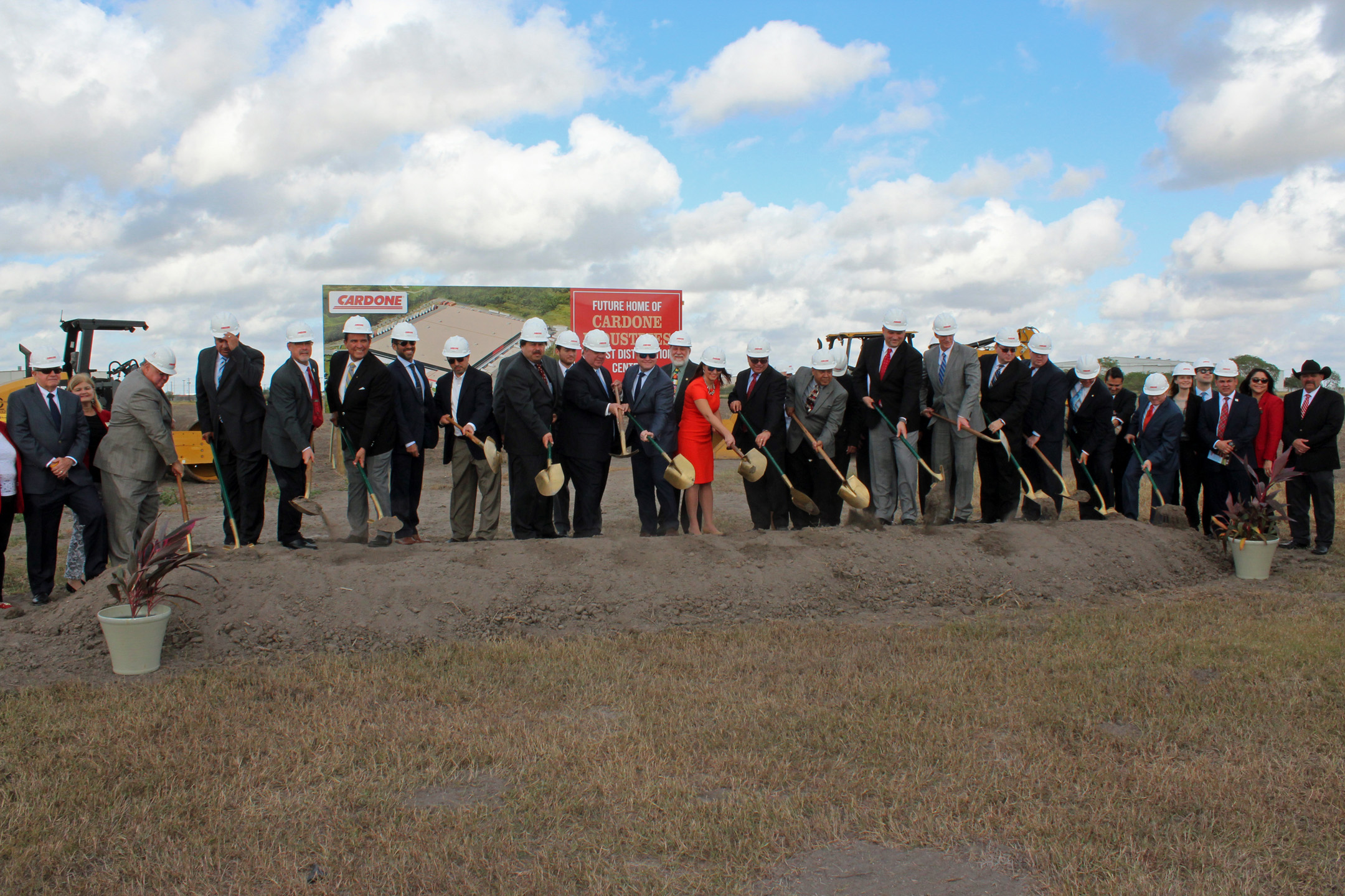 Cardone Industries officials and local dignitaries turned shovels of dirt for the groundbreaking ceremony.