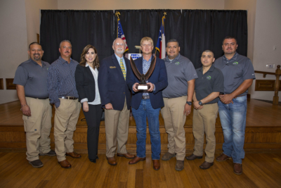Brownsville Navigation District Chairman John Wood (fourth from left) presents the Chairman's Award to ISL President Chris Green (center) and the ISL management team. (photo Port of Brownsville)