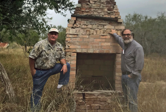 Charles Edward Wetegrove and his brother Raymond with Edward Burleson Raymond's 1886 chimney that was part of the original house.