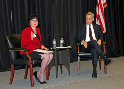 Economics professor Marie T. Mora moderates a discussion with Robert Kaplan, president and CEO of the Federal Reserve Bank of Dallas. (VBR)