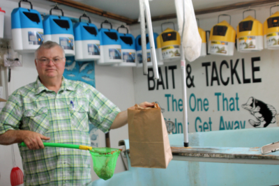 Gary Williams gets ready to put live shrimp inside a brown bag filled with sawdust. (VBR)