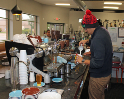 A barrista prepares a specialty coffee drink at 7th and Park.