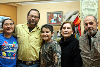 Armando Duarte Rios and his family at the boot shop in Raymondville. (VBR)