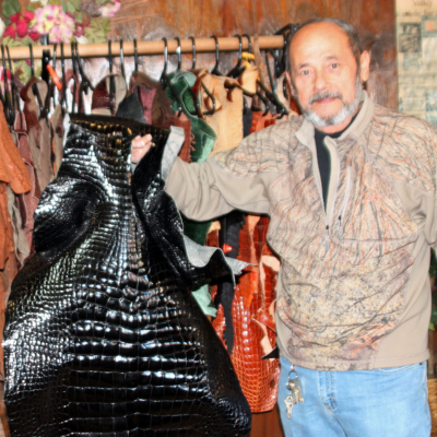 Armando Duarte Rios shows one of the many exotic skins he has in the shop.
