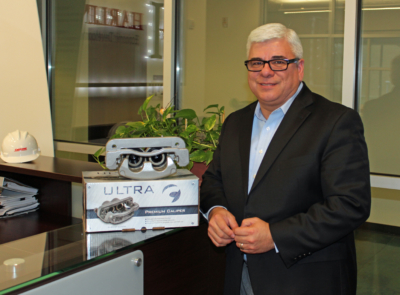 Harlingen Economic Development Corporation CEO Raudel Garza with a brake caliper remanufactured by CORDONE. (VBR)