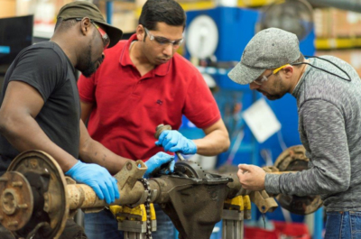 CARDONE workers disassemble a rear axle at the company's remanufacturing operation in Matamoros. (Courtesy)