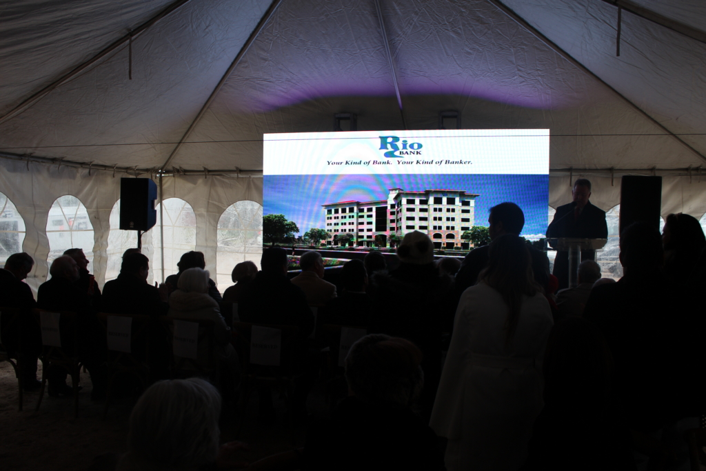 Guests view a rendering of the new new six-story Rio Bank coming to North McColl in McAllen.