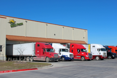 Trucks backed up to the loading docks at the Index Fresh facility in Pharr.