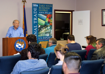 Retired businessman and SCORE volunteer Lionel Levin speaks to a group of aspiring entrepreneurs. (VBR)