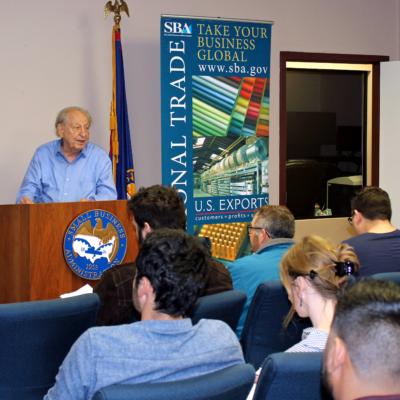 Retired businessman and SCORE volunteer Lionel Levin speaks to a group of aspiring entrepreneurs. (VBR)