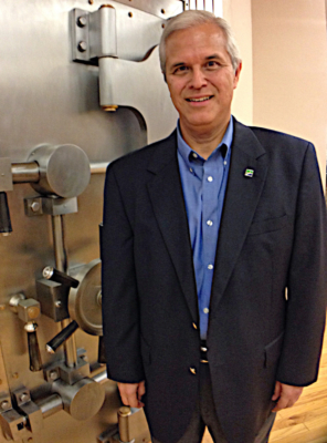 Greater State Bank President and CEO David Salinas in front of the vault.