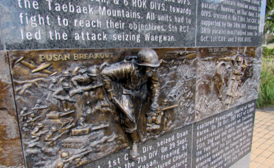 A Marine jumps into action on Clark's Korean War plaque at the Veterans War Memorial of Texas. (VBR)