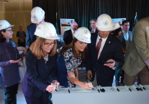 Area leaders sign a beam to be used in the construction of the new Weslaco UTRGV Center for Innovation and Commercialization in Weslaco, (Photo by Paul Chouy, UTRGV)