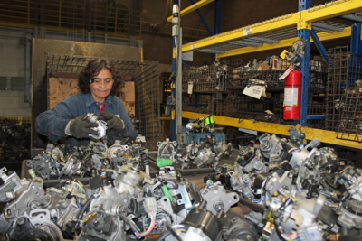 A woman sorts automotive parts at the existing CARDONE receiving plant in Harlingen. (VBR)