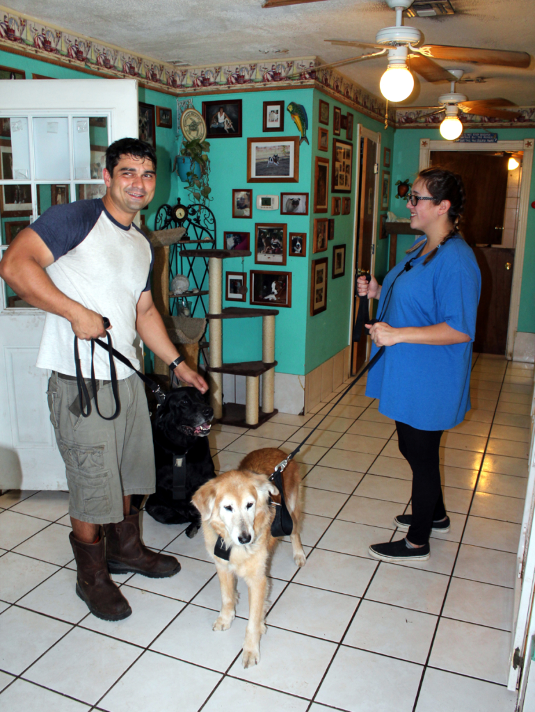 Gabriel Palacios and Constance, the granddaughter of owners John and Liz Patterson, welcome two daycare pets being dropped off by their owners. (VBR)