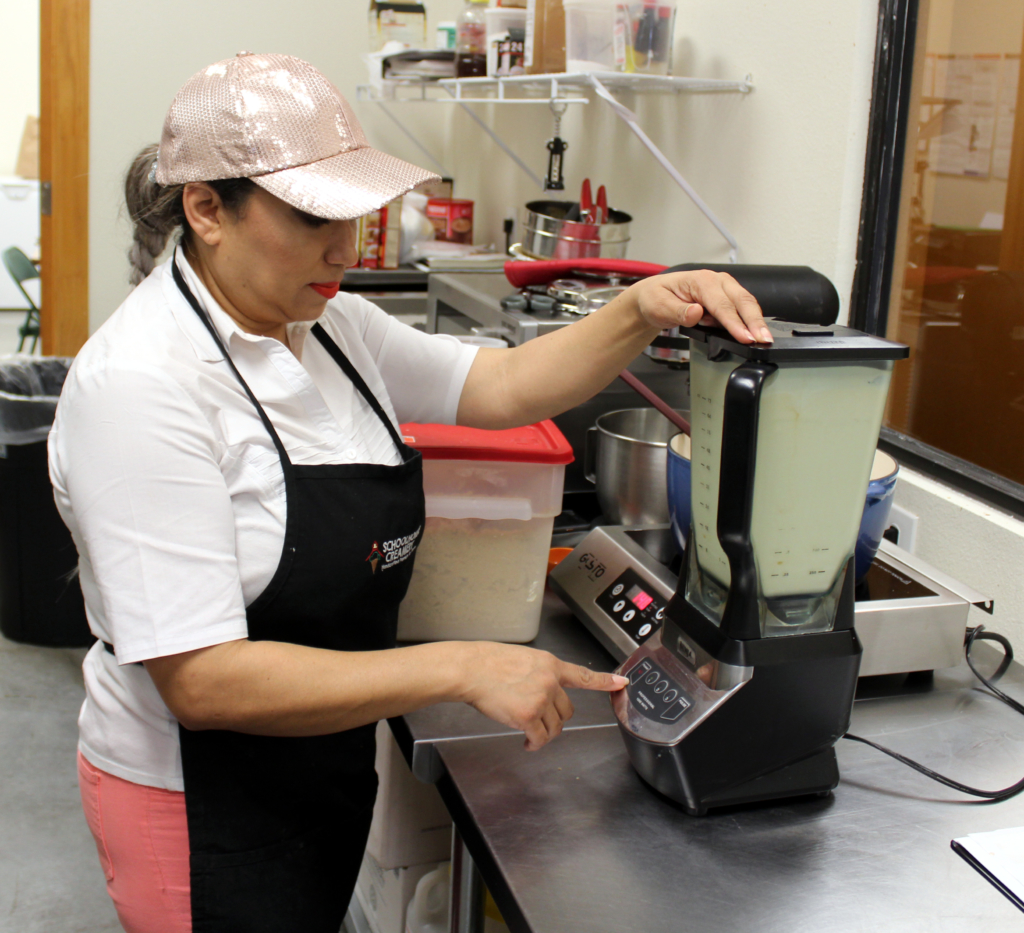 Owner Claudia Martinez personally mixes ingredients for a batch of ice cream. (VBR)