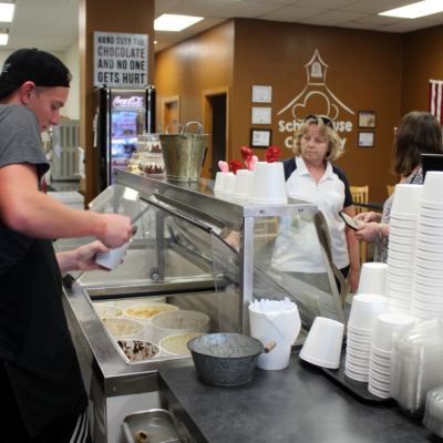 A server prepares ice cream orders for customers. (VBR)