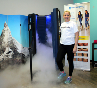 Vaporized nitrogen flows from a cryosauna as Cryo Body Perfections owner Margret DeBruyn holds the door open. (VBR)