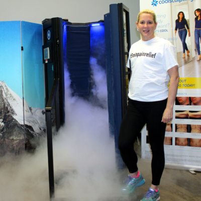 Vaporized nitrogen flows from a cryosauna as Cryo Body Perfections owner Margret DeBruyan holds the door open. (VBR)
