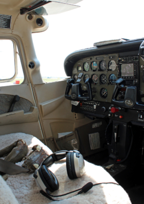 Students first take the controls in the cockpit of a single-engine Cessna. (VBR)