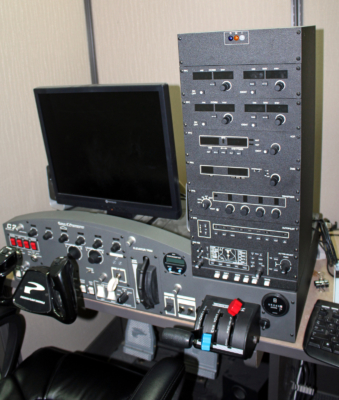 A computerized flight simulator is used to teach instrument flying to students. (VBR)